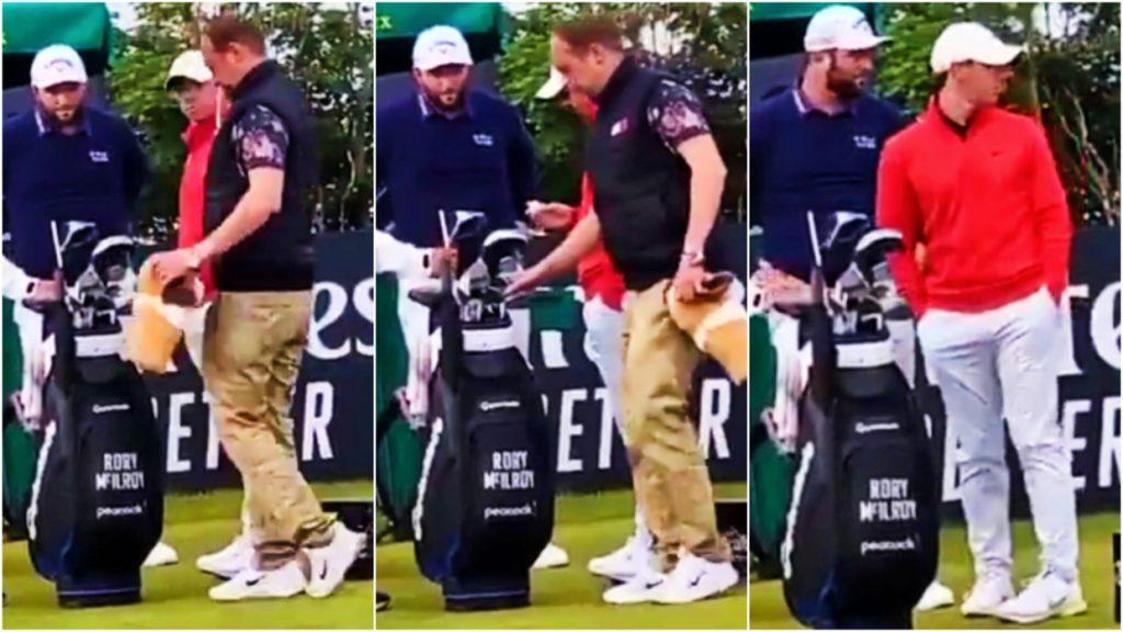 Seorang penonton mengambil stick golf Rory McIlroy saat pegolf Skorlandia itu bermain